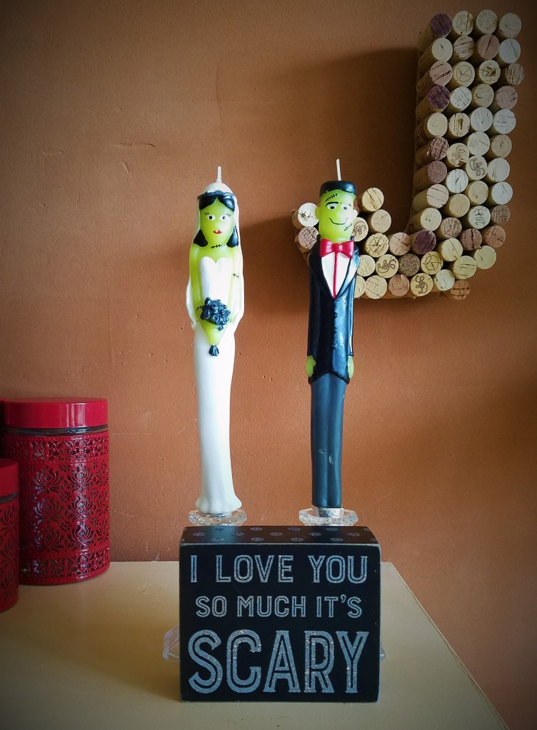frankenstein monster bride and groom candles and wooden block reading: I love you so much it's scary