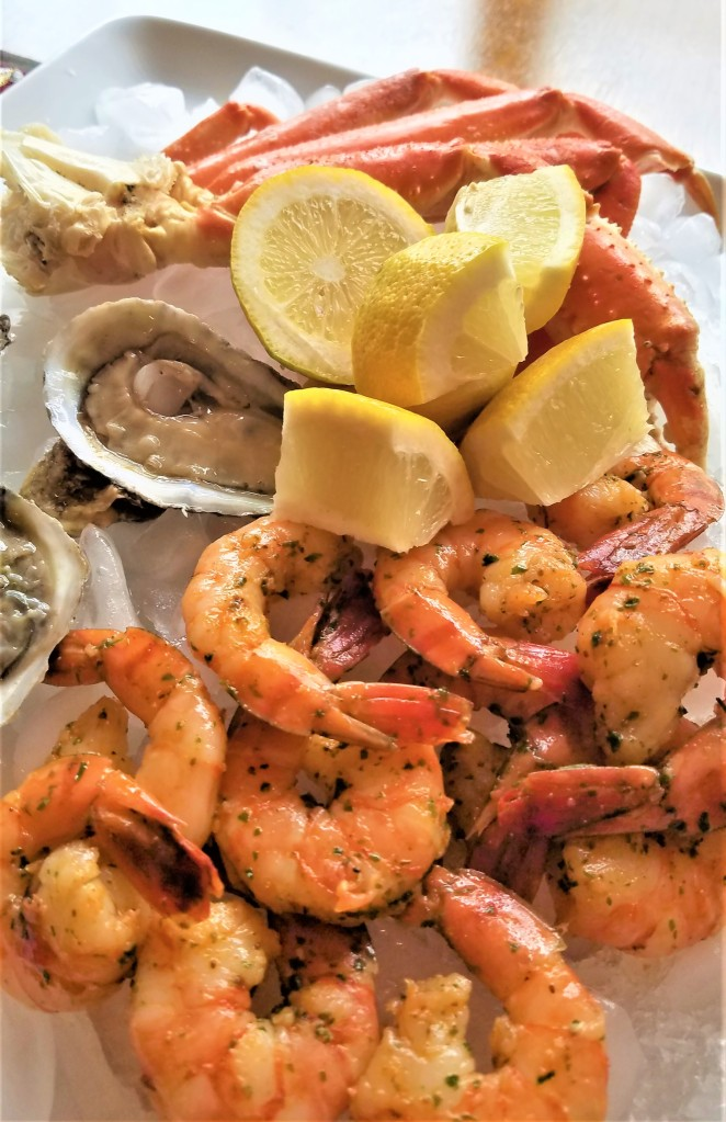 homemade seafood platter with snow crab legs, oysters, and shrimp
