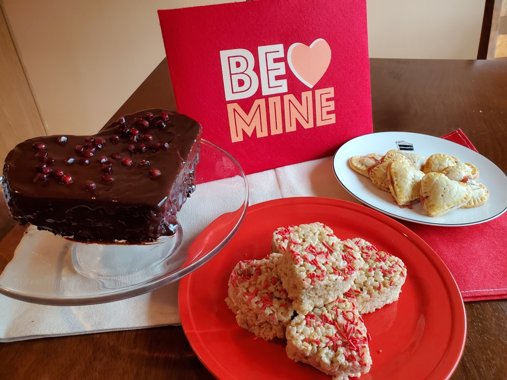 Valentine's Treat Table with cake, hand pies, and rice krispie treats