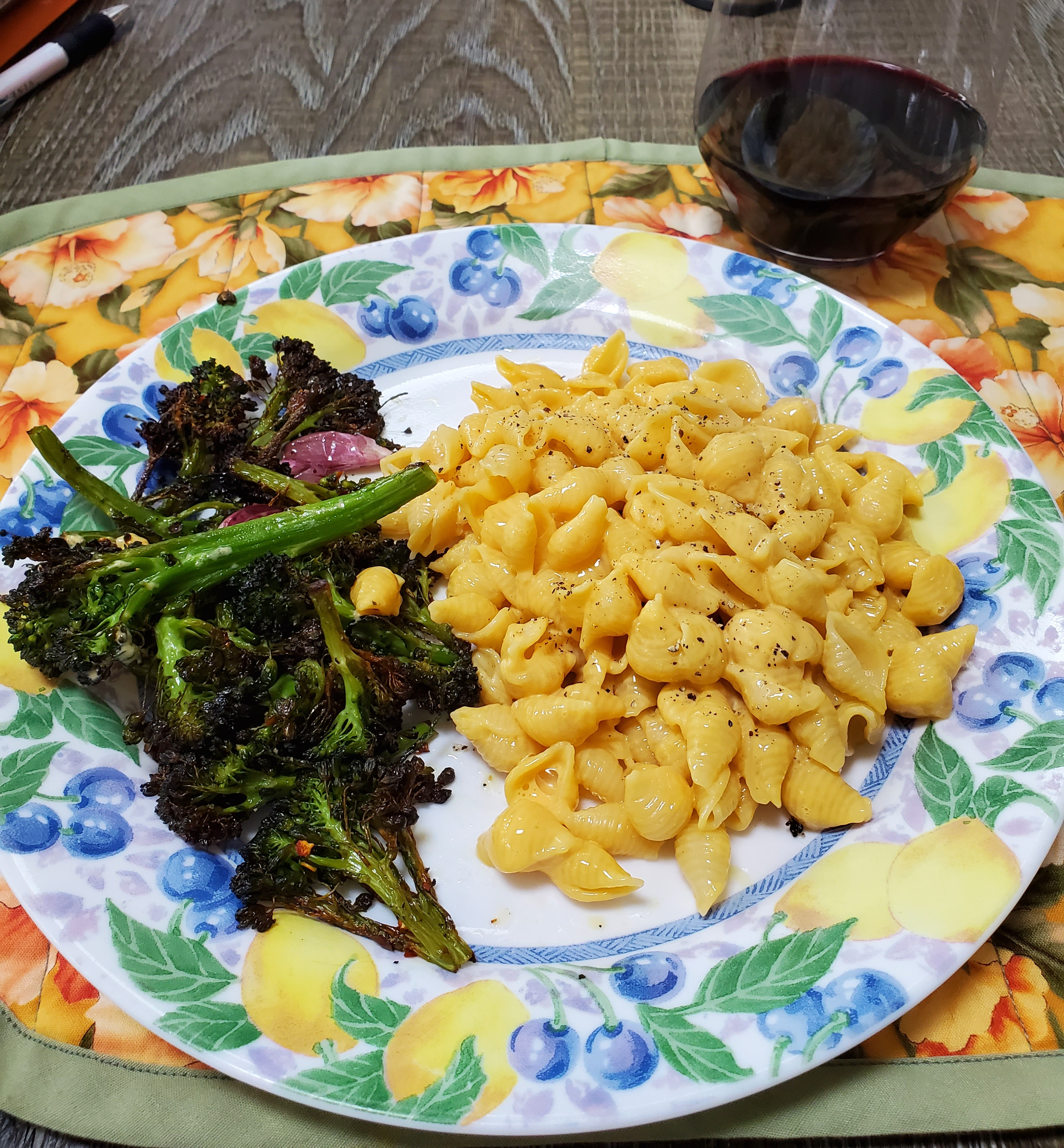 photo of plated lunch with glass of wine and instant macaroni and roasted broccoli rabe